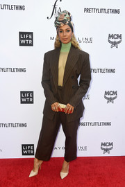 Leona Lewis sported a Marc Jacobs ensemble, consisting of a baggy brown suit and a sheer mint-green top, for the 2018 Fashion Los Angeles Awards.