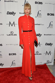 Karlie Kloss was military-chic in a long-sleeve red Ronald van der Kemp Couture shirtdress at the Fashion Media Awards.