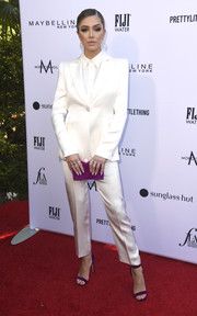 Delilah Hamlin looked perfectly chic in a white satin pantsuit at the 2019 Fashion Los Angeles Awards.