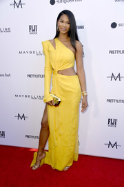Chanel Iman styled her dress with gold triple-strap sandals by Giuseppe Zanotti.