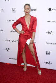 Jasmine Sanders was red-hot in a PrettyLittleThing wrap dress with a plunging neckline and a high slit at the 2019 Fashion Los Angeles Awards.