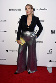 For a pop of color, Busy Philipps accessorized with a yellow satin clutch.