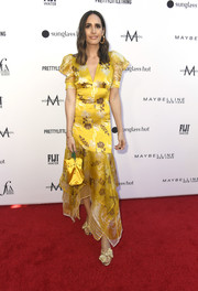 Louise Roe was summer-chic in a yellow Silvia Tcherassi print dress with puffed sleeves and a handkerchief hem at the 2019 Fashion Los Angeles Awards.
