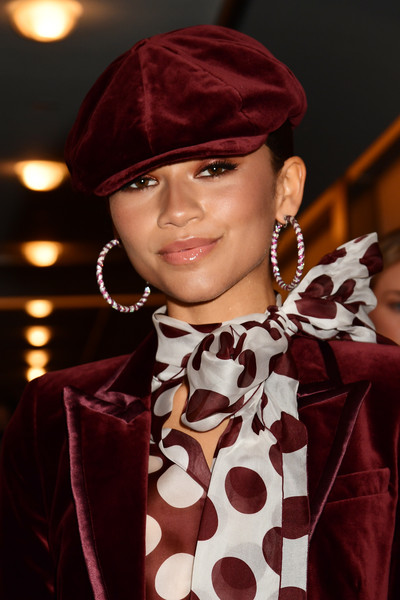 Zendaya Coleman accessorized with a maroon velvet newsboy cap to match her jacket at the 2019 Fashion Media Awards.