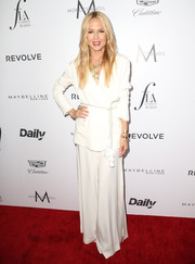 Rachel Zoe chose a white wide-leg pantsuit from her own label for her Fashion Los Angeles Awards look.
