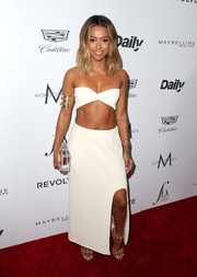 Karrueche Tran matched her skimpy top with a white maxi skirt.