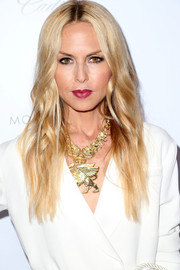 Rachel Zoe styled her white suit with a chunky gold pendant necklace.