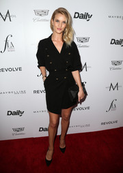 Rosie Huntington-Whiteley sweetened up her dress with a bow-embellished suede clutch by Victoria Beckham.