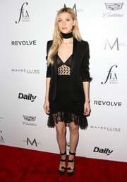 NIcola Peltz pulled her head-turning outfit together with a pair of strappy black platform sandals by Versace.