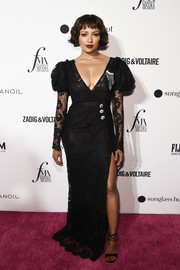 Kat Graham went for vintage glamour in a black Alessandra Rich lace gown with Juliet sleeves at the 2018 Fashion Media Awards.