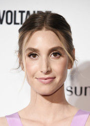Whitney Port styled her hair into a center-parted bun for the 2018 Fashion Media Awards.