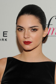 Kendall Jenner sported a rich red lip for a pop of color to her black outfit.