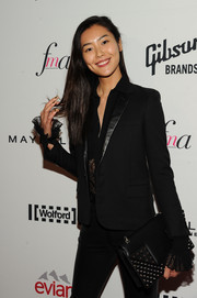 Liu Wen teamed a studded black clutch with a pantsuit for an androgynous-chic vibe at the Fashion Media Awards.