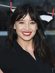 Daisy Lowe sported tousled layers with center-parted bangs at the Give Up Clothes for Good photocall.