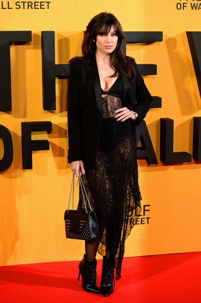 Daisy Lowe Studded Shoulder Bag [the wolf of wall street,clothing,red carpet,carpet,fashion,yellow,flooring,footwear,premiere,formal wear,outerwear,daisy lowe,part,london,uk,england,odeon leicester square,premiere]