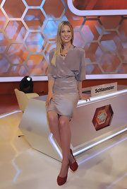 Sarah Brandner went for a timelessly chic look with a shimmery gray wrap dress during the 'Dalli Dalli' photocall.