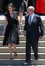 Wendi Deng arrived at Dame Elisabeth Murdoch's memorial wearing a pleated A-line LBD.