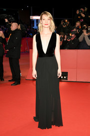 Mia Wasikowska worked a down-to-the-navel neckline at the Berlinale premiere of 'Damsel'!