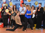 Shawn Johnson showed her dance moves on 'Good Morning America' wearing a sleeveless cobalt blouse and black leggings.