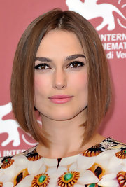 Keira Knighley wore her hair in a dramatic, A-line bob to 'A Dangerous Method' photocall in Venice. To try this look at home, add a small amount of Phytodefrisant Botanical Hair Relaxing Balm to damp hair and blow-dry straight. Make a center part and comb tresses properly into place.