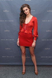 Taylor Hill showed off her legs in a red mini dress at the Daniel Wellington store opening.