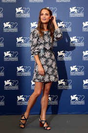 Alicia Vikander attended the Venice Film Fest photocall for 'The Danish Girl' wearing a Louis Vuitton paisley mini with leather accents on the waist.