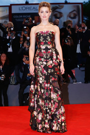 Amber Heard oozed ultra-feminine appeal in an Alexander McQueen floral strapless gown at the Venice Film Fest premiere of 'The Danish Girl.'