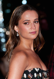 Alicia Vikander attended the 'Danish Girl' UK premiere wearing her hair in a cascade of waves.