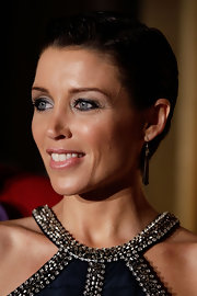 Dannii Minogue accented her shimmering gown and sleek 'do with simple dangling earrings at an event in Sydney, Australia.