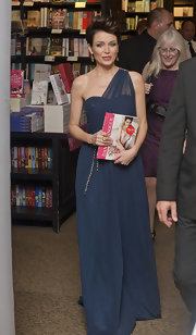 Dannii Minogue wore a luxe blue gown at a book signing in Greenhithe, England.