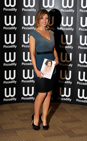 Danni Minogue loves cascading colors.  Here she wears a blue fading cowl neck slim fitting cocktail dress, belted with black, at her book signing.