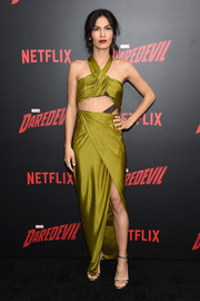 Elodie Yung completed her look with strappy gold evening sandals.