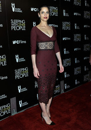 Amanda Peet cut a stylish figure at the premiere of 'Sleeping with Other People' in a burgundy cocktail dress with a nipped-in lace waist.
