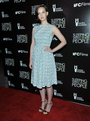 Gold sandals with patterned wedges sealed off Jess Weixler's outfit.