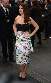 The shape and floral print of Charlotte Riley's cocktail dress exuded a flirty 1950s vibe.