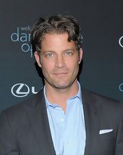 Nate Berkus keeps his medium brown hair longer on top and slightly tousled.