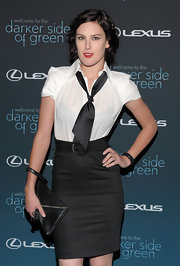 Rumer donned a darkened do with vibrant lipstick and a fitted, two-piece ensemble.
