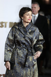 Kristin Scott Thomas paired a black satin clutch with a printed coat for the UK premiere of 'Darkest Hour.'