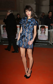 Caroline Sieber showed her funky side with this sheer dress with floral appliques for her quirky red carpet style.