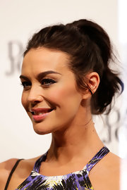 Megan Gale swept her hair up in a high ponytail for a cool finish to her look during the David Jones collection launch.