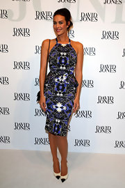Megan Gale sported a feminine silhouette at the David Jones collection launch in a print dress with a peplum waist and a halter neckline.