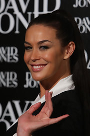 Megan Gale wore her long straight hair in a neat ponytail when she attended the David Jones autumn/winter season launch.