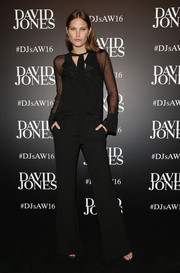 Catherine McNeil arrived for the David Jones fashion launch wearing a black ruffle blouse by Chloe.