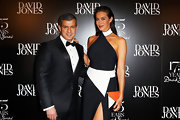 Megan Gale paired a tricolor envelope clutch with a black-and-white halter dress for a totally modern feel at the 175th anniversary party of David Jones.