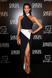 Megan Gale exuded a modern-chic vibe at the 175th anniversary party of David Jones in a black-and-white halter gown with a thigh-high slit.