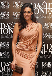 Megan Gale's animal-print clutch was a striking complement to her Grecian dress at the David Jones flagship store opening.