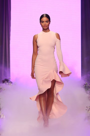 Shanina Shaik sashayed down the David Jones runway wearing an asymmetrical baby-pink fishtail dress by By Johnny.