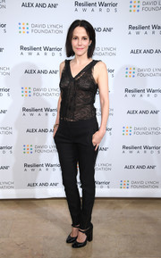 Mary-Louise Parker kept the rest of her look casual with a pair of black skinny pants.