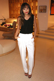 Ashley Madekwe was monochrome-chic in white slacks and a black tank top at the Tool Chest Collection event.