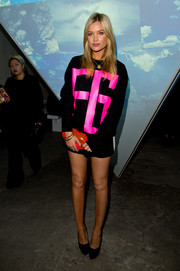 Laura Whitmore's hot pink graphic-print sweatshirt is hard to miss at the Fyodor Golan show during London Fashion Week.
